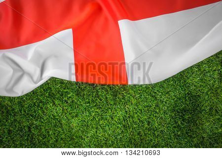 Flags of England on green grass