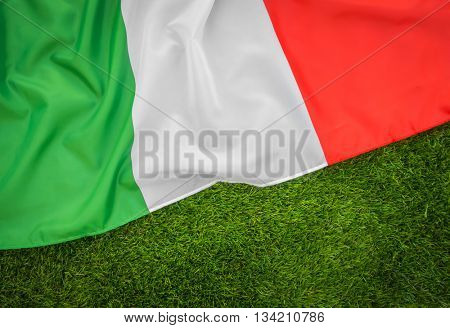 Flags of Italy on green grass