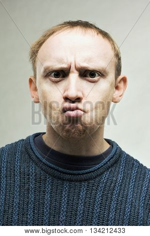 Young perplexed real man with dark eyes