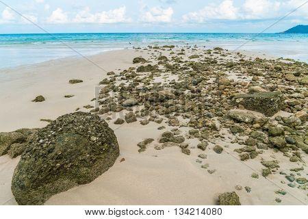 Beautiful white sand beach with blue sea and sky