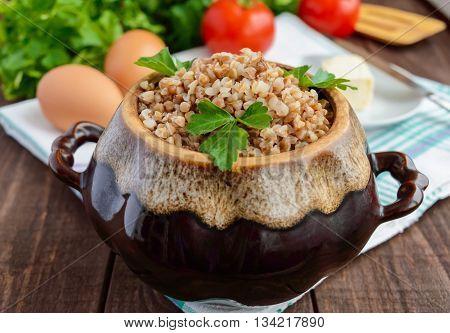 Buckwheat porridge in white bowl. Dietary dish. Vegan.