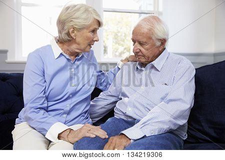 Wife Talking To Depressed Senior Husband At Home