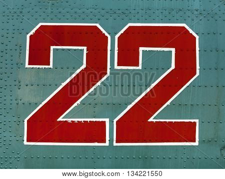 Red 22 Numbers On Aircraft Fuselage Close Up.
