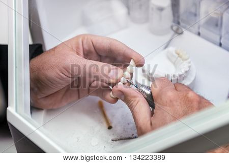 Prosthetic Dentistry Technician Working In His Office