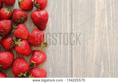 Strawberries on wooden grey desk. Stock photo.