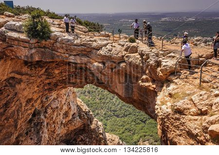 KESHET CAVE, UPPER GALILEE, ISRAEL - MAY 12, 2016: People touring the site of the natural phenomenon of the Keshet (Arch) Cave.