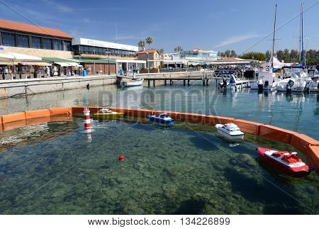 PAPHOS CYPRUS - APRIL 20 2016:Paphos yacht club with moored boats and skipper training simulator on April 20 in Paphos Cyprus.Paphos -ancient city included in UNESCO list