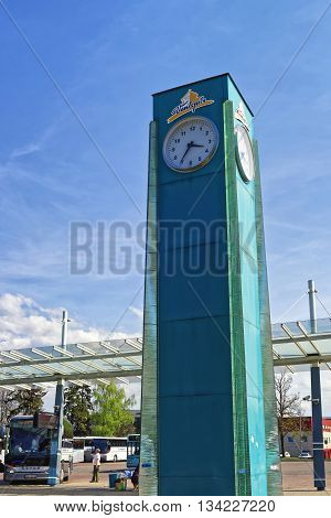 Bus Terminal With Passengers And Clock In Ventspils In Latvia