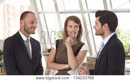 Confident caucasian business team meeting at office. Wearing suit, smiling, bristly.