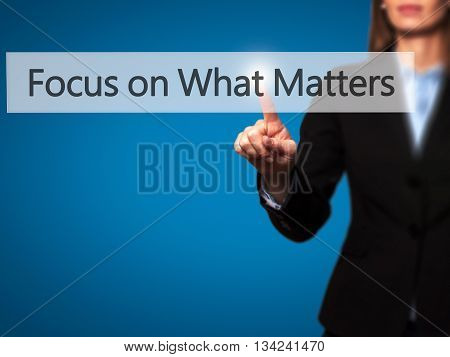Focus On What Matters - Businesswoman Hand Pressing Button On Touch Screen Interface.