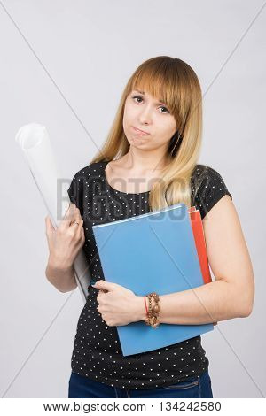 Young Girl Student With A Project In Hand And Angrily Looks Into The Frame
