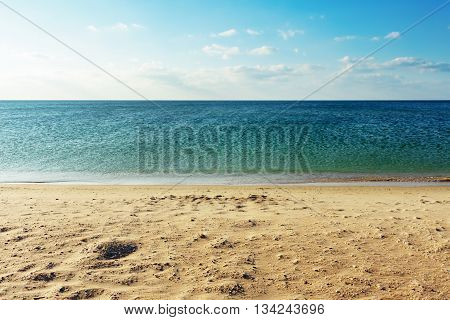 Beautiful seascape. Marine background. Black Sea beach. The Black Sea coast. Sky sea and sand. Tranquil scene with a sea view. poster