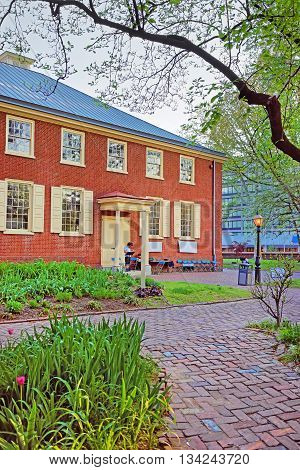 Philadelphia, USA - May 5, 2015: Arch Street Friends Meeting House in the Old City of Philadelphia Pennsylvania USA. It is a quakers religious society of Friends. People in the street