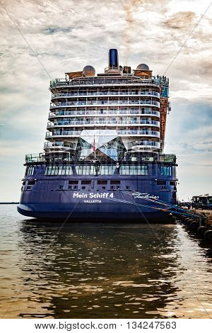 GDYNIA, POLAND - MAY 31, 2016: The magnificent luxury cruise ship the Mein Schiff 4 is docked at wharf in Port of Gdynia.