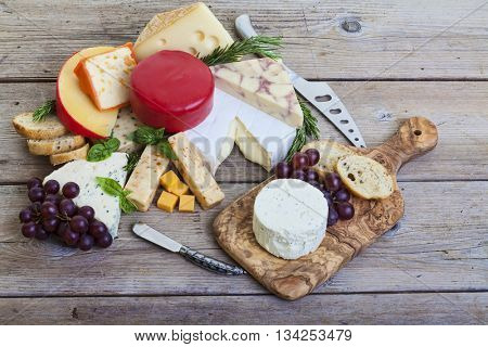 Assorted cheese on wood platter