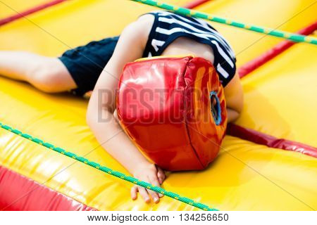 Defeated Boy Lying In A Boxing Helmet