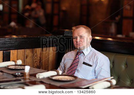Man Poses In Restaurant