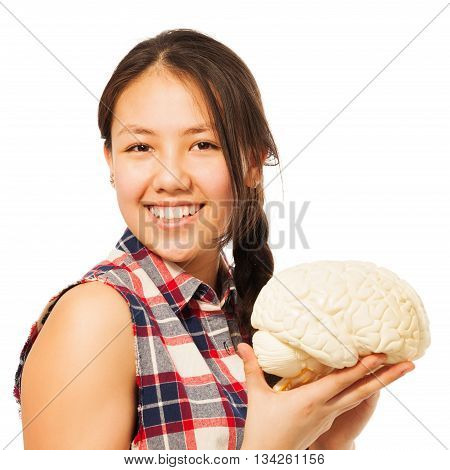 Cute Asian 15 years old girl holding cerebrum model, isolated on white