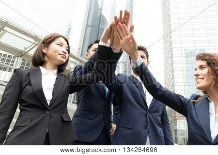 Group of business people joining hand