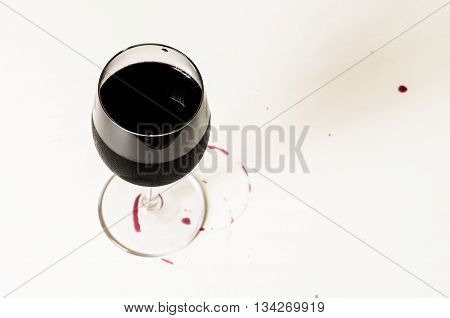 Cold wine Cabernet or Merlot top view and stains on the table