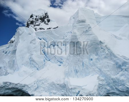 Cracks and crevices of a crumbling iceberg about to fall in Antarctica