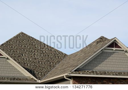 Asphalt Shingles on a Hip Roof with Gable Dormers on a Residential House