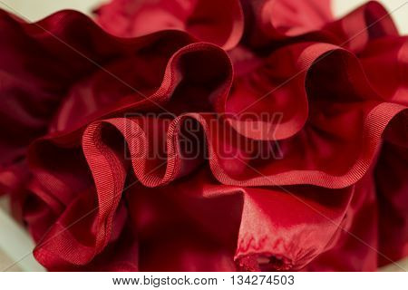 Ruffles and seams of a red garment or dress