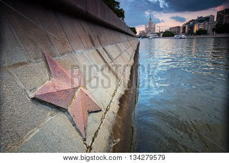 Red granite star in Moscow city on the river with the same name as the town