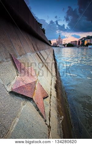 Red granite soviet star in Moscow city on the river with the same name as the town