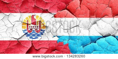 french polynesia flag with Luxembourg flag on a grunge cracked w
