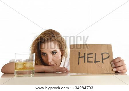 drunk alcoholic blond woman drinking whiskey glass asking for help holding message board depressed wasted and sad isolated on white background in alcohol abuse and housewife alcoholism