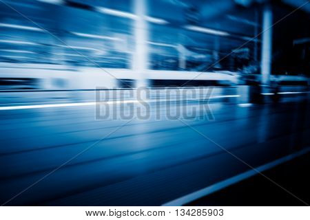 high-speed train at the railway station, motion blurred,china.