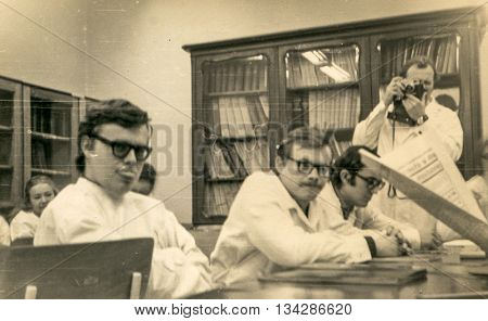 LODZ, POLAND, CIRCA 1970'S: Vintage photo of medicine school students during workshops