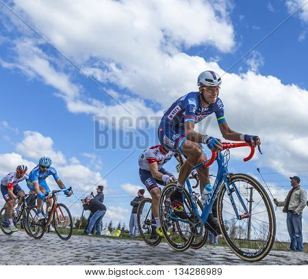 Hornaing France - April 10,2016: Group of cyclists riding in the peloton on a paved road in Hornaing France during Paris Roubaix on 10 April 2016.