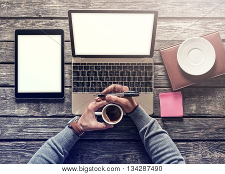 Top view mockup - laptop and tablet pc with cup of coffee. Clipping paths included.
