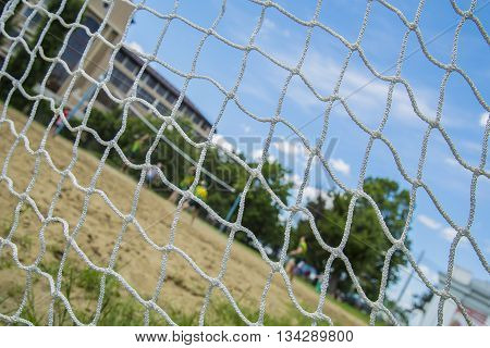 Beach volleyball players through the net. Games in Rio.