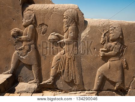 Bas relief carvings of dignitaries and representatives bringing gifts to the Achaemenian King in Persepolis of Shiraz.