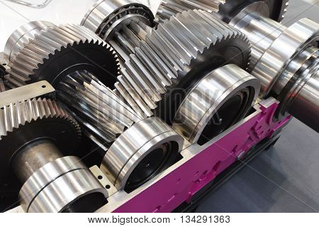 new metal gear wheels lie on work table