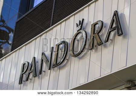MADRID. SPAIN - MARCH 17. 2016: The sign for a Pandora jewellery store in Madrid Spain. Pandora is an international Danish jewelry manufacturer and retailer founded in 1982.