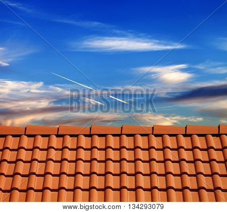 Roof tiles in evening and sky with sunlight clouds