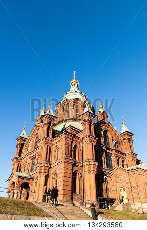 HELSINKI FINLAND - circa MARCH 2016: Helsinki Red Chruch.  Uspenski Cathedral is an Eastern Orthodox cathedral in Helsinki, Finland, dedicated to the Dormition of the Theotokos (the Virgin Mary).