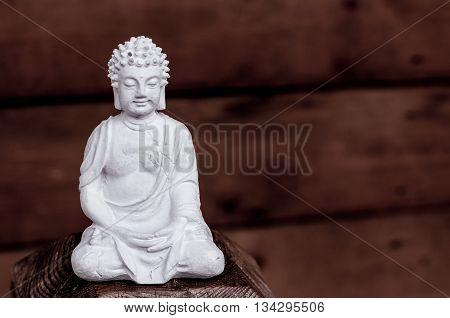 White Buddha - peaceful mind on dark background.