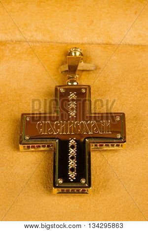 cross with the icon in the center on a brown background