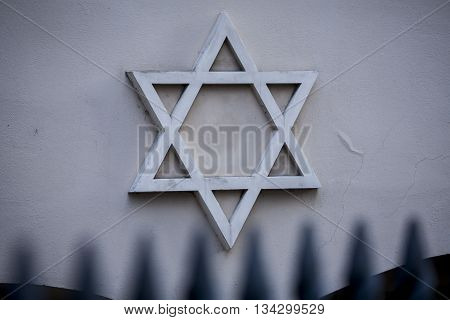 Star of David symbol of Judaism, the symbol of the Jews on wall.