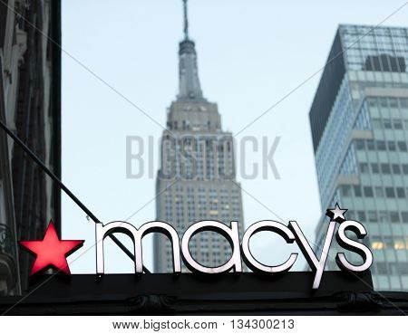 New York City, USA - May 28, 2016: Historic macy's store signage in front of the Empire State Building in Midtown Manhattan, New York
