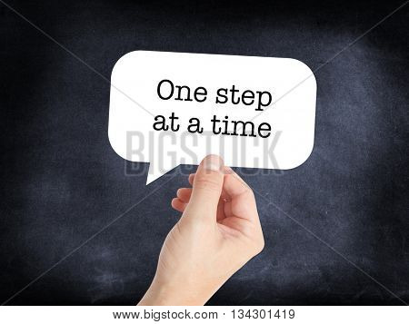One step at a time written on a speechbubble