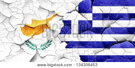 Cyprus flag with Greece flag on a grunge cracked wall
