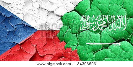 czechoslovakia flag with Saudi Arabia flag on a grunge cracked w