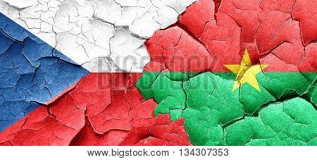 czechoslovakia flag with Burkina Faso flag on a grunge cracked w