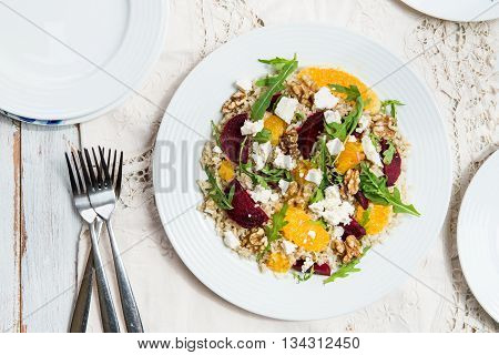 Warm Healthy Quinoa, Brown Rice, Cooked Beetroot And Orange Salad